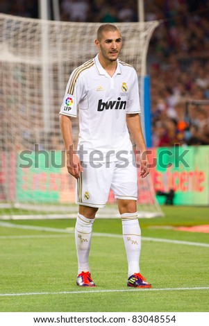 BARCELONA - AUGUST 17: Karim Benzema in action during the Spanish Supercup final match between FC Barcelona and Real Madrid, 3 - 2, on August 17, 2011 in Barcelona, Spain.