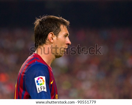 BARCELONA - AUGUST 17: Leo Messi in action during the Spanish Super Cup final match between FC Barcelona and Real Madrid, 3 - 2, on August 17, 2011 in Barcelona, Spain.