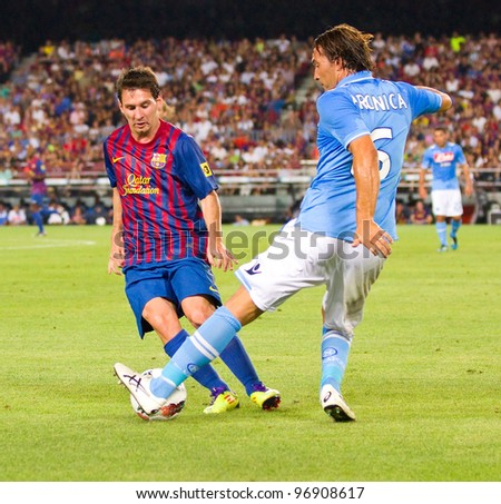 BARCELONA - AUGUST 22: Leo Messi (L) and Salvatore Aronica in action during the Gamper Trophy final match between FC Barcelona and Napoli, final score 5 - 0, on August 22, 2011, in Barcelona, Spain.