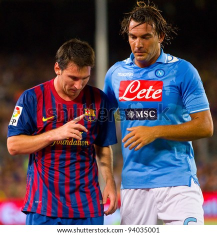 BARCELONA - AUGUST 22: Lionel Messi (L) and Salvatore Aronica during the Gamper Trophy final match between FC Barcelona and Napoli, final score 5 - 0, on August 22, 2011 in Camp Nou, Barcelona, Spain.