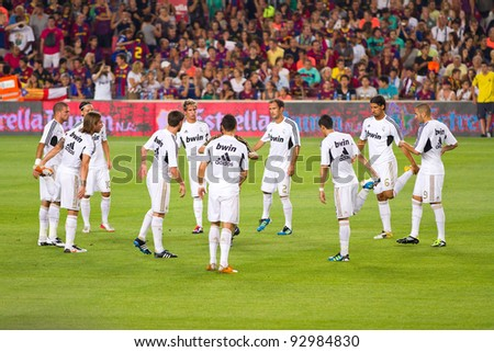 BARCELONA - AUGUST 17: Madrid players warm-up before the Spanish Super Cup final match between FC Barcelona and Real Madrid, 3 - 2, on August 17, 2011 in Camp Nou stadium, Barcelona, Spain.