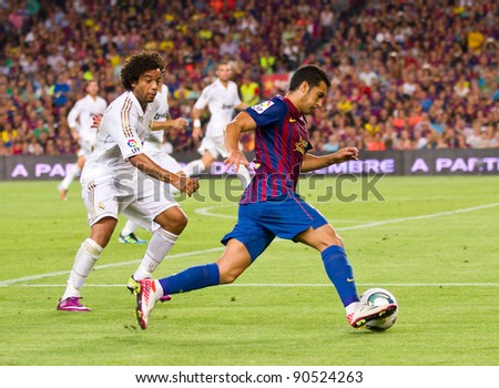 BARCELONA - AUGUST 17: Marcelo Vieira and Pedro Rodriguez (R) in action during the Spanish Super Cup final match between FC Barcelona and Real Madrid, 3 - 2, on August 17, 2011 in Barcelona, Spain.
