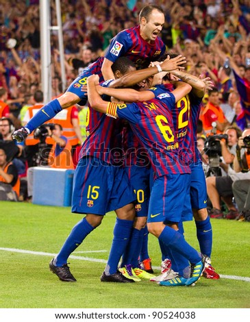 BARCELONA - AUGUST 17: Players celebrates the goal of Leo Messi during the Spanish Super Cup final match between FC Barcelona & Real Madrid, 3 - 2, on August 17, 2011 in Barcelona, Spain.