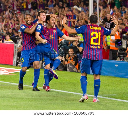 BARCELONA - AUGUST 17: Players celebrating the goal of Leo Messi (min. 88) during the Spanish Super Cup final match between FC Barcelona and Real Madrid, 3 - 2, on August 17, 2011 in Barcelona, Spain.
