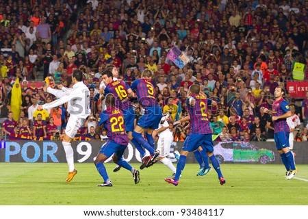 BARCELONA - AUGUST 17: Players in action during the Spanish Super Cup final match between FC Barcelona and Real Madrid, 3 - 2, on August 17, 2011 in Camp Nou stadium, Barcelona, Spain.
