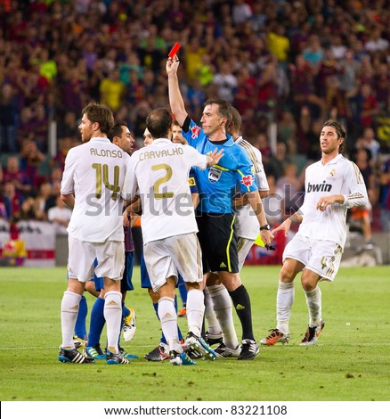 BARCELONA - AUGUST 17: Referee giving red card to Marcelo Vieira during the Spanish Supercup final match between FC Barcelona and Real Madrid, 3 - 2, on August 17, 2011 in Barcelona, Spain.
