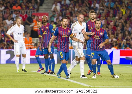 BARCELONA - AUGUST 17: Some players in action at the Spanish Super Cup final match between FC Barcelona and Real Madrid, 3 - 2, on August 17, 2011 in Camp Nou stadium, Barcelona, Spain.