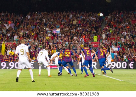 BARCELONA - AUGUST 17: Some players in action during the Spanish Supercup final match between FC Barcelona and Real Madrid, 3 - 2, on August 17, 2011 in Barcelona, Spain.