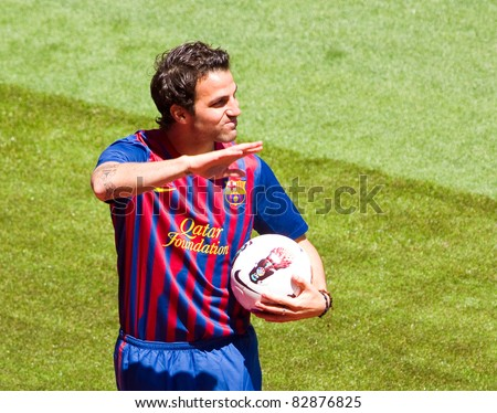 BARCELONA - AUGUST 15: Spanish footballer Cesc Fabregas during his presentation as new FC Barcelona player in Camp Nou stadium, on August 15, 2011, in Barcelona, Spain. - stock photo