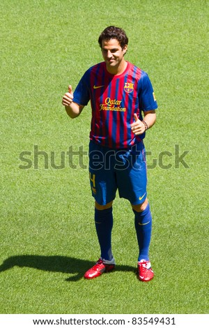 BARCELONA - AUGUST 15: Spanish footballer Cesc Fabregas during his presentation as new FC Barcelona player in Camp Nou stadium, on August 15, 2011, in Barcelona, Spain.