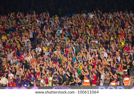 BARCELONA - AUGUST 17: Unidentified people celebrate a goal at the Spanish Super Cup final match between FC Barcelona and Real Madrid, 3 - 2, on August 17, 2011 in Camp Nou stadium, Barcelona, Spain.