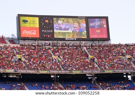 BARCELONA - AUGUST 22: Unidentified supporters during the Gamper Trophy final match between FC Barcelona and Napoli, final score 5 - 0, on August 22, 2011 in Camp Nou stadium, Barcelona, Spain.