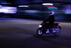 Barcelona biker driving in the night