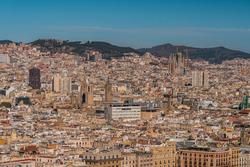 Barcelona city skyline and La Sagrada Familia cathedral aerial view, Spain