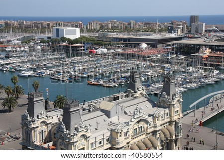 Barcelona cityscape. Aerial view seen from the Columbus Column. Port Vell, marina and Barceloneta district.