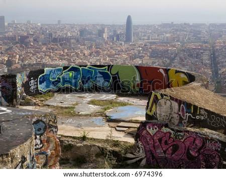 Barcelona cityscape from a concrete platform full of graffiti paints