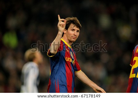 BARCELONA - DEC 12: Leo Messi of Barcelona celebrates goal during a Spanish League match between FC Barcelona and Real Sociedad at the Nou Camp Stadium on December 12, 2010 in Barcelona, Spain - stock photo