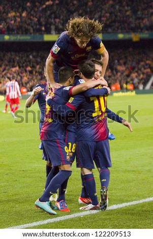 BARCELONA - DECEMBER 16: Barcelona players celebrating a goal during the Spanish League match between FC Barcelona and Atletico de  Madrid, final score 4 - 1, on December 16, 2012 in Barcelona, Spain.
