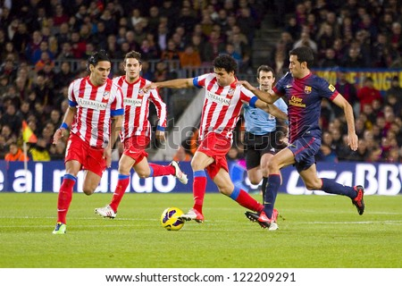 BARCELONA - DECEMBER 16: Some players in action at the Spanish League match between FC Barcelona and Atletico de  Madrid, final score 4 - 1, on December 16, 2012, in Camp Nou, Barcelona, Spain.