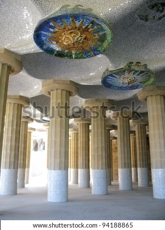 Barcelona: detail of ceramic mosaic ceilings at the Columns Hall in Park Guell, the famous and beautiful park designed by Antoni Gaudi, one of the highlights of the city