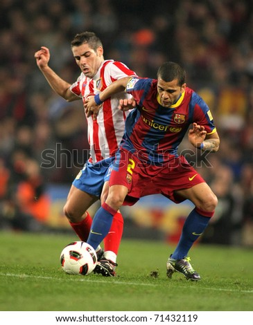 BARCELONA  - FEB 5: A. Lopez(L) of Atletico fight with Alves(R) of Barcelona during the match between FC Barcelona and Atletico Madrid at the Nou Camp Stadium on February 5, 2011 in Barcelona, Spain