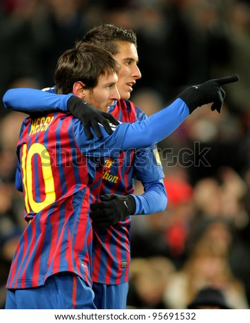 BARCELONA - FEB 4: Leo Messi with Cristian Tello of FC Barcelona celebrate goal during spanish league match against Real Sociedad at the Camp Nou stadium on February 4, 2012 in Barcelona, Spain