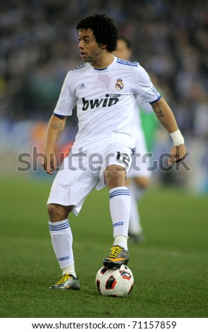 BARCELONA - FEB 13: Marcelo Vieira of Real Madrid during a spanish league match between Espanyol and Real Madrid at the Estadi Cornella on February 13, 2011 in Barcelona, Spain