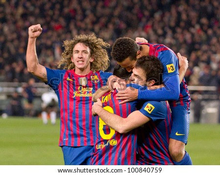 BARCELONA - FEBRUARY 2: Barcelona players celebrate a goal during the Spanish Cup match between FC Barcelona and Valencia, final score 2-0, on February 2, 2012, in Camp Nou stadium, Barcelona, Spain.