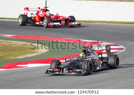 BARCELONA - FEBRUARY 19: Esteban Gutierrez (R) racing with his new Sauber C32 at Formula One Teams Test Days at Catalunya circuit on February 19, 2013 in Montmelo, Barcelona, Spain.