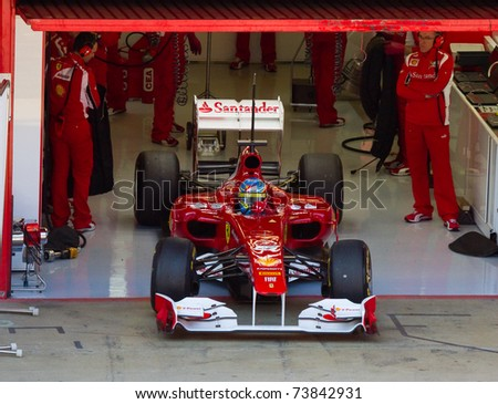 BARCELONA - FEBRUARY 18: Fernando Alonso (Ferrari) in the pit during Formula One Teams Test Days at Catalunya circuit on February 18, 2011 in Barcelona, Spain. - stock photo