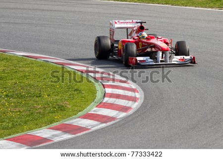 BARCELONA - FEBRUARY 18: Fernando Alonso (Ferrari) tests his F1 car during Formula One Teams Test Days at Catalunya circuit February 18, 2011 in Barcelona (Spain). - stock photo