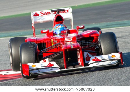 BARCELONA - FEBRUARY 21: Fernando Alonso of Ferrari F1 team races during Formula One Teams Test Days at Catalunya circuit on February 21, 2012 in Barcelona, Spain. - stock photo