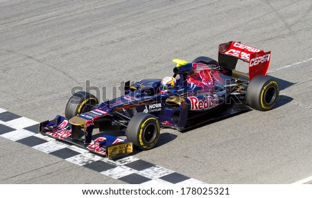 BARCELONA - FEBRUARY 21: Jean Eric Vergne of Toro Rosso F1 team racing at Formula One Teams Test Days at Catalunya circuit on February 21, 2012 in Barcelona, Spain.