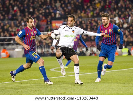 BARCELONA - FEBRUARY 2: Jonas Oliveira (middle) in action during the Spanish Cup match between FC Barcelona and Valencia CF, final score 2-0, on February 2, 2012 in Camp Nou stadium, Barcelona, Spain.