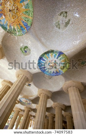 BARCELONA - FEBRUARY 18: Park guell  in Barcelona with mosaic medallions on the ceiling of the terrace.The vibrant colors of the tiles are breathtaking on February 18, 2011 in Barcelona, Spain