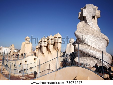 BARCELONA - FEBRUARY 18:The architect  Gaudi treated rooftop elements  like chimneys  as striking sculptures on the rooftop of the house Casa Mila /La Pedrera on February 18, 2011 in Barcelona, Spain