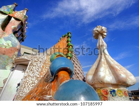 BARCELONA - FEBRUARY 18: The famous architect Gaudi�­ treated rooftop chimneys like pieces of art on the rooftop of the house Casa Batllo on February 18, 2011 in Barcelona, Spain.