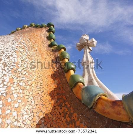 BARCELONA - FEBRUARY 18: The famous architect Gaudi­ treated rooftop chimneys like pieces of art on the rooftop of the house Casa Batllo on February 18, 2011 Barcelona, Spain