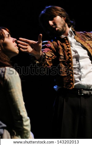 BARCELONA - JAN 13: An actor slaps an actress in the face. Both actors of the Barcelona Theater Institute, plays in the comedy Shakespeare For Executives on January 13, 2013 in Barcelona, Spain.