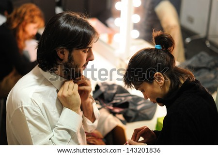 BARCELONA - JAN 13: An actor Theater Institute, dresses and prepares to go on stage in the comedy Shakespeare For Executives on January 13, 2013 in Barcelona, Spain.