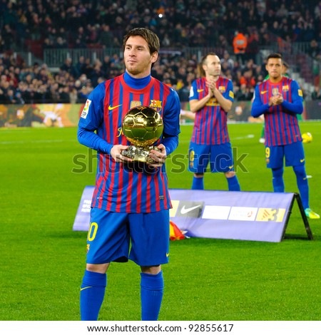 BARCELONA – JAN. 15: Leo Messi poses with FIFA World Player Gold Ball Award in Camp Nou stadium before the match between FC Barcelona vs Betis, on January 15, 2012, Barcelona, Spain.