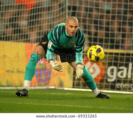 BARCELONA - JAN 12: Victor Valdes of Barcelona in action during the match between FC Barcelona and Real Betis at the Nou Camp Stadium on January 12, 2011 in Barcelona, Spain
