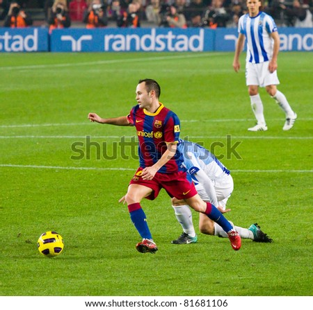 BARCELONA - JANUARY 16: Andres Iniesta in dribbling action during Spanish League match between FC Barcelona and Malaga, 4 - 1. January 16, 2011 in Camp Nou stadium, Barcelona, Spain.
