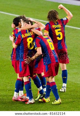 BARCELONA - JANUARY 16: Barcelona players celebrating a goal during Spanish League match between FC Barcelona and Malaga, 4 - 1. January 16, 2011 in Camp Nou stadium, Barcelona, Spain.