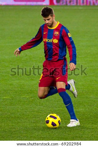 BARCELONA - JANUARY 12: Camp Nou football stadium, soccer Spanish Cup match: FC Barcelona - Real Betis, 5 - 0. In the picture, Gerard Pique in action. January 12, 2011 in Barcelona (Spain).