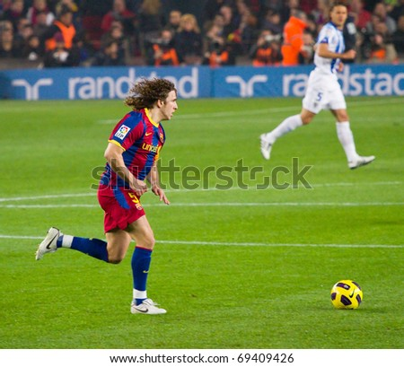 BARCELONA - JANUARY 16: Camp Nou soccer stadium, Spanish League match: FC Barcelona - Malaga, 4 - 1. In the picture, Carles Puyol in action. January 16, 2011 in Barcelona (Spain).