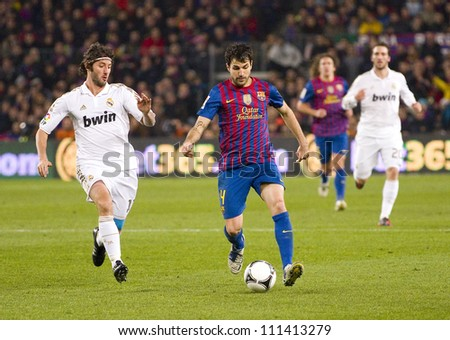 BARCELONA - JANUARY 25: Cesc Fabregas (middle) of FCB in action during the Spanish Cup match between FC Barcelona and Real Madrid, final score 2 - 2, on January 25, 2012, in Barcelona, Spain. - stock photo