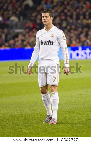 BARCELONA - JANUARY 25: Cristiano Ronaldo in action at the Spanish Cup match between FC Barcelona and Real Madrid, final score 2 - 2, on January 25, 2012, in Camp Nou, Barcelona, Spain.