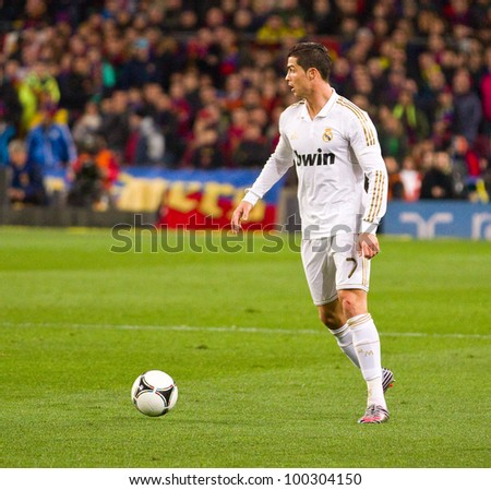 BARCELONA - JANUARY 25: Cristiano Ronaldo of Madrid in action during the Spanish Cup match between FC Barcelona and Real Madrid, final score 2 - 2, on January 25, 2012, in Barcelona, Spain.