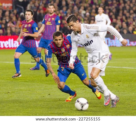 BARCELONA JANUARY 25 Cristiano Ronaldo R in action at the Spanish Cup match between FC Barcelona and Real Madrid final score 2 2 on January 25 2012 in Camp Nou Barcelona Spain